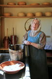 Young woman in period dress, reenacting life of a pilgrim,Old Sturbridge Village,Massachusetts,September,2014 Royalty Free Stock Image