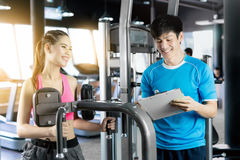 Young woman and personal trainer Stock Photography
