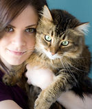 Young woman with pet cat. A young woman holding her pet Maine Coon cat Stock Photos