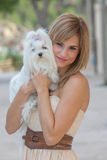 Young woman with pet Maltese dog royalty free stock photos