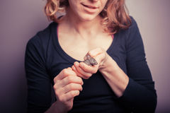 Young woman with pet mouse. A young woman is holding her tiny pet mouse Royalty Free Stock Photos