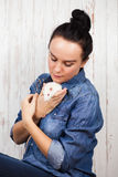 Young woman with a pet rat Royalty Free Stock Photos