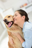 Young woman petting her dog with tenderness Stock Photos