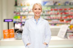 Young woman pharmacist drugstore or pharmacy Royalty Free Stock Photography