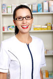 Young woman in pharmacist uniform Royalty Free Stock Photography