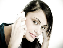 Young woman on phone Royalty Free Stock Photography