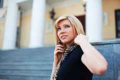 Young fashion woman calling on the cell phone Royalty Free Stock Photography