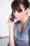 Young woman on phone Royalty Free Stock Images