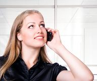 Young woman with phone Stock Photography