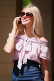 Young woman on the phone Stock Photography