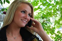 Young woman on phone. A young woman talking on the phone Royalty Free Stock Images