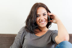Young woman on the phone Stock Image