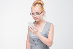 Young woman with phone angry, peeved and irritated Royalty Free Stock Images