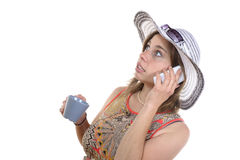 Young woman on the phone and drinking a glass Stock Photos