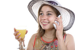 Young woman on the phone and drinking a glass Stock Image