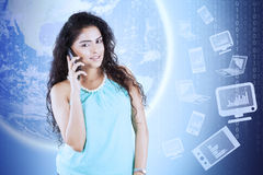 Young woman with phone and earth Royalty Free Stock Images