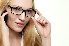 Young Woman with a phone in glasses Stock Images