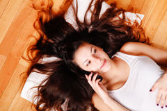 Young woman with phone Stock Images