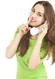 Young woman on the phone, keeping silent Stock Images