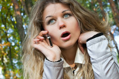 The young woman with phone in park Royalty Free Stock Image