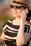 Young woman on phone Stock Images