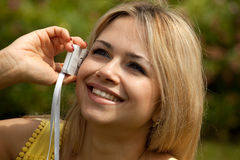 Young woman on phone representative smiling Stock Photos