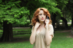 Young woman on the phone. Serious young woman talking on the phone Stock Photos