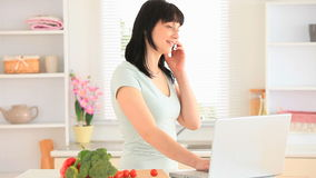 Young woman on the phone while surfing on the internet stock video