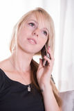 Young woman on the phone talking Royalty Free Stock Photography