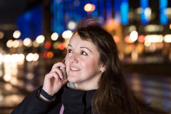 Young woman with a phone in town Stock Images