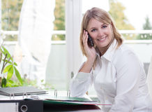 Young woman phones Stock Image