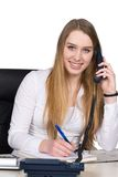Young woman phones at the desk Stock Photo