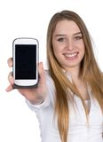 Young woman phones shows a smart phone to the camera stock photography
