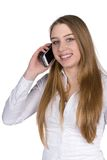 Young woman phones with a smart phone. Cut out image of a young smiling woman who is phoning with a smart phone while looking to the camera Stock Photos