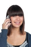 Young woman phones with a smartphone Stock Image