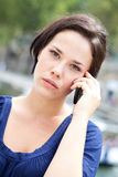 Young woman phoning Stock Photography