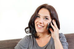 Young woman phoning. Nice brunette phoning and smiling Stock Photos
