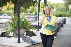 Young woman phoning Royalty Free Stock Image