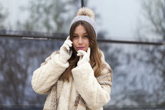 Young woman phoning Royalty Free Stock Photography