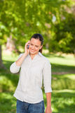 Young woman phoning in the park Stock Photography