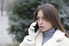 Young woman phoning in the park Royalty Free Stock Image