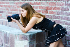 Young woman with photo camera Stock Photography