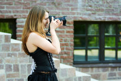 Young woman with photo camera. Stock Photography