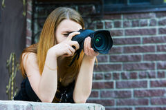 Young woman with a digital photo camera Stock Photos