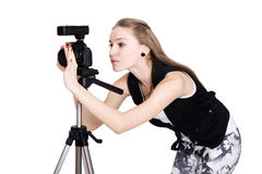 A young woman with a photo camera Royalty Free Stock Photos