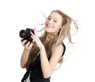 A young woman with a photo camera Stock Photo