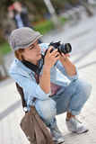 Young woman photo reporter in town working Stock Images