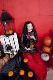 Young woman in photo studio on Halloween. Beautiful children on Halloween in the studio Stock Images
