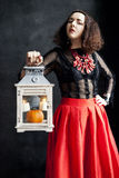 Young woman in photo studio on Halloween Royalty Free Stock Photography