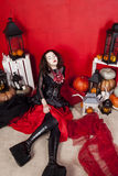 Young woman in photo studio on Halloween. Young women in photo studio Royalty Free Stock Photo